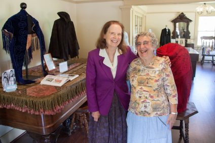 """Historical Society member Diane Lewis, a retired textile professor from Saddleback College, stands with longtime resident and Historical Society member Jan Siegel in the Leck House. In May 2016, the house was home to an exhibit titled, """"The Ladies of Historic San Juan Capistrano,"""" which showcased intricately stitched clothing and artifacts from historic San Juan families. Photo: Allison Jarrell"""