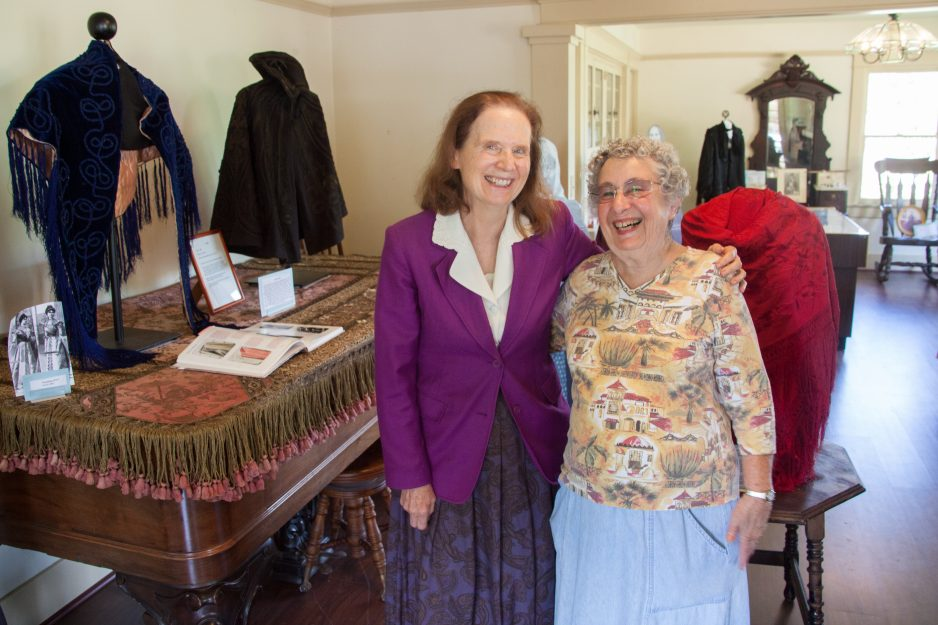 "Historical Society member Diane Lewis, a retired textile professor from Saddleback College, stands with longtime resident and Historical Society member Jan Siegel in the Leck House. In May 2016, the house was home to an exhibit titled, ""The Ladies of Historic San Juan Capistrano,"" which showcased intricately stitched clothing and artifacts from historic San Juan families. Photo: Allison Jarrell"