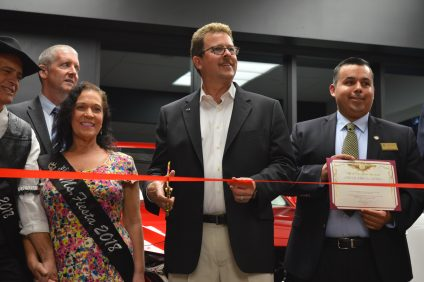 San Juan Capistrano Mazda Co-Owner Miles Brandon cuts a ribbon during the ribbon-cutting ceremony on Thursday, Feb. 1. The ceremony revealed the dealership's new retail evolution showroom. Photo: Emily Rasmussen