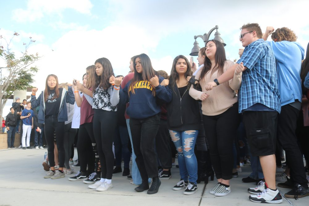 Students link arms during a moment of silence for the Parkland, Florida victims.
