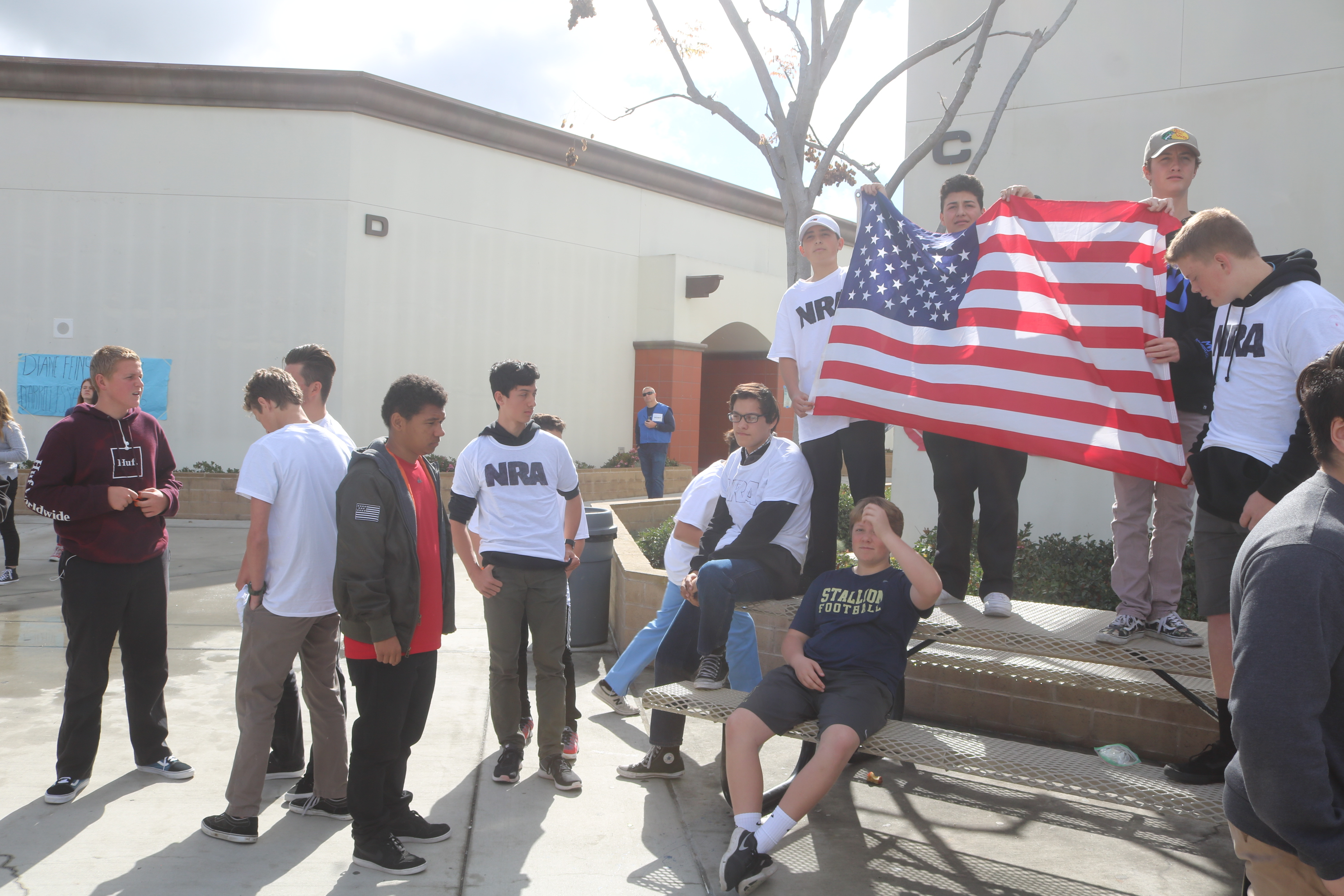 Students express support to the NRA and the 2nd Amendment during the demonstration.