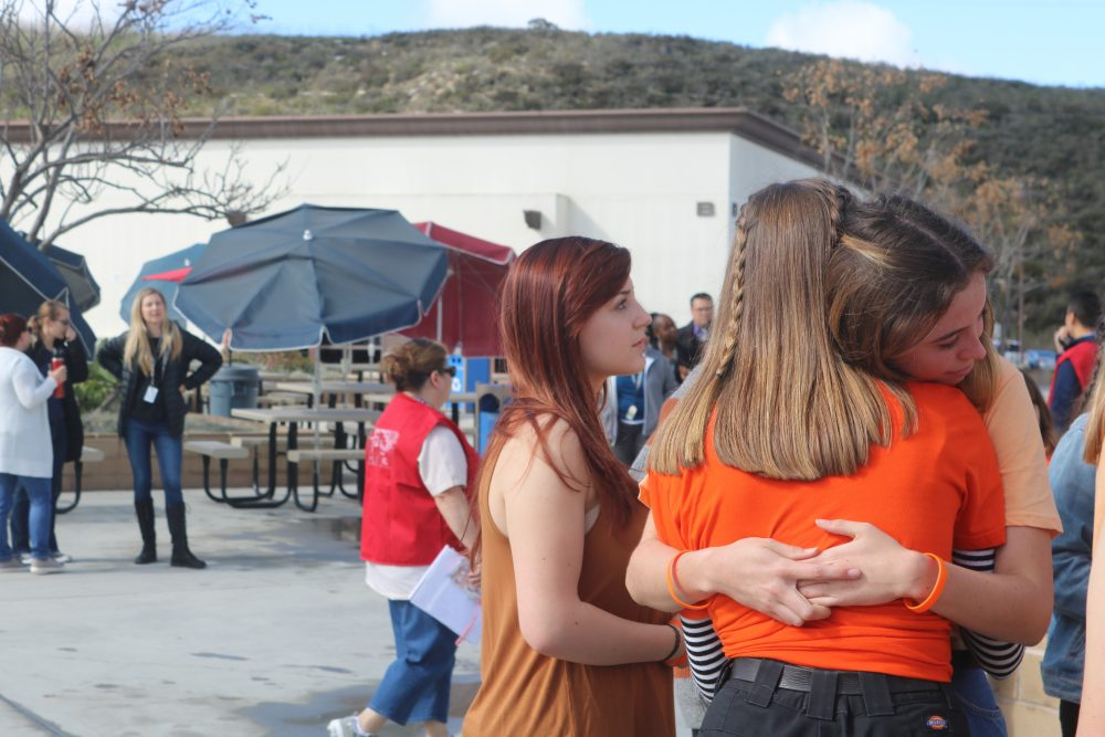 Students hug each other for support after the demonstration.