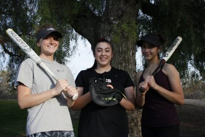 Riley Dungan, Lauren Herber and Alexia Harrison provide experience for a young but energetic group of Capistrano Valley Christian softball players. Photo: Zach Cavanagh