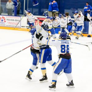 Brendan Williams (left) celebrates Santa Margarita's USA Hockey national championship after Leevi Selanne's game-winning overtime goal. Photo: Courtesy