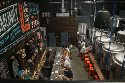 At Docent Brewing in San Juan Capistrano, you can grab a well-crafted beer while playing a game of oversize Jenga, shuffleboard, foosball or kick back in the lounge while ordering some food. Photo: Eric Heinz
