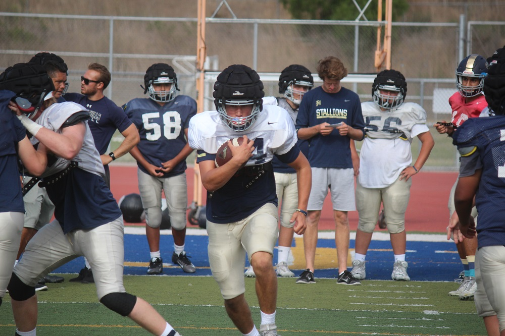 San Juan Hills senior running back Chase Monarch (center) is one of just a few returners for the Stallions offense. Coach Rob Frith, in his first season with San Juan Hills, has used the summer to find who will fill some of those open offensive roles. Photo: File