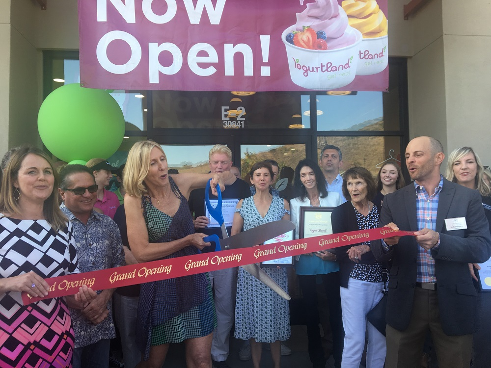 Members of the business community turn out for a ribbon cutting at the new Yogurtland location in Sendero Marketplace in Rancho Mission Viejo.