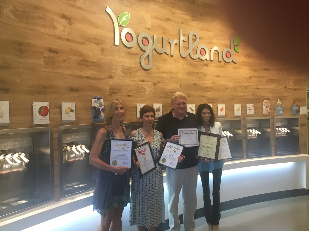 Yogurtland owners Elizabeth Hargreaves, Michelle Bogart,  Dana MacKay and Effie Nikzad pose for a picture following a ribbon cutting event on July 15.