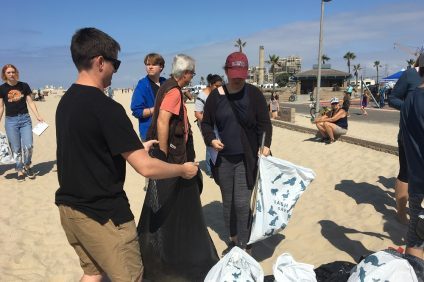 Volunteers clear debris from a beach during last year's Coastal Cleanup Day. This year 40 Orange County sites, including San Juan Capistrano's Descanso Park, are slated for clean up.