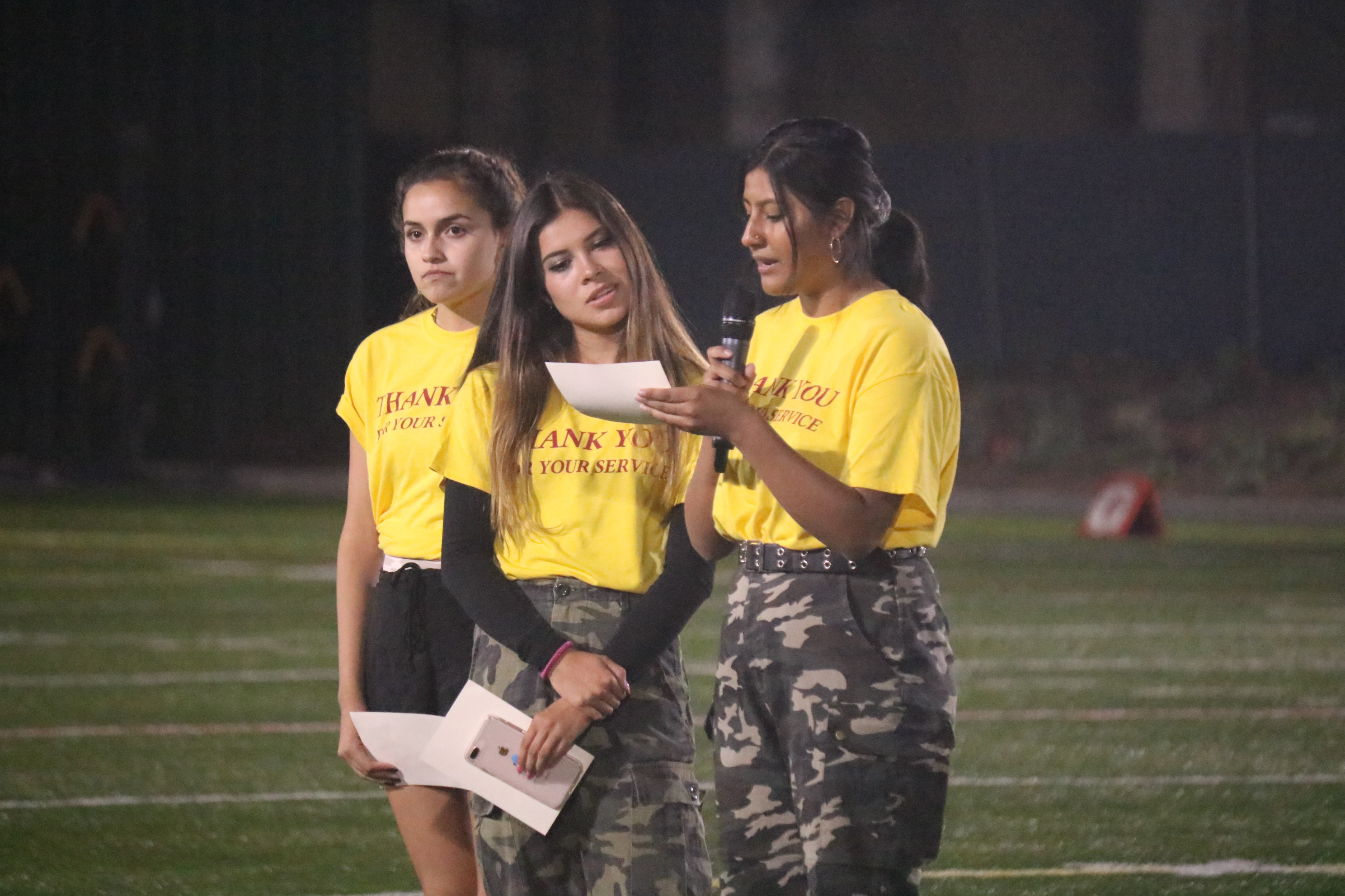 St. Margaret's students participate in a Military Appreciation Night event after the first quarter. Photo: Zach Cavanagh
