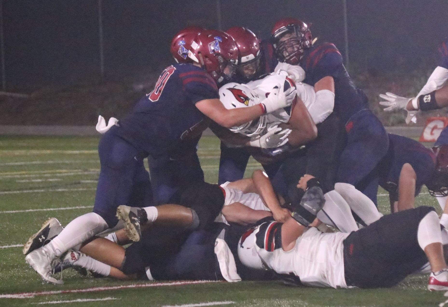 St. Margaret's defense swarms a Bishop Diego runner. Photo: Zach Cavanagh