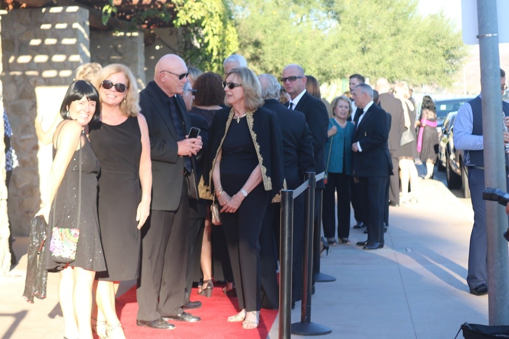 Guests line up on a red carpet for the Romance of the Mission Gala on Friday, Sept. 14. Photo: Alex Groves.