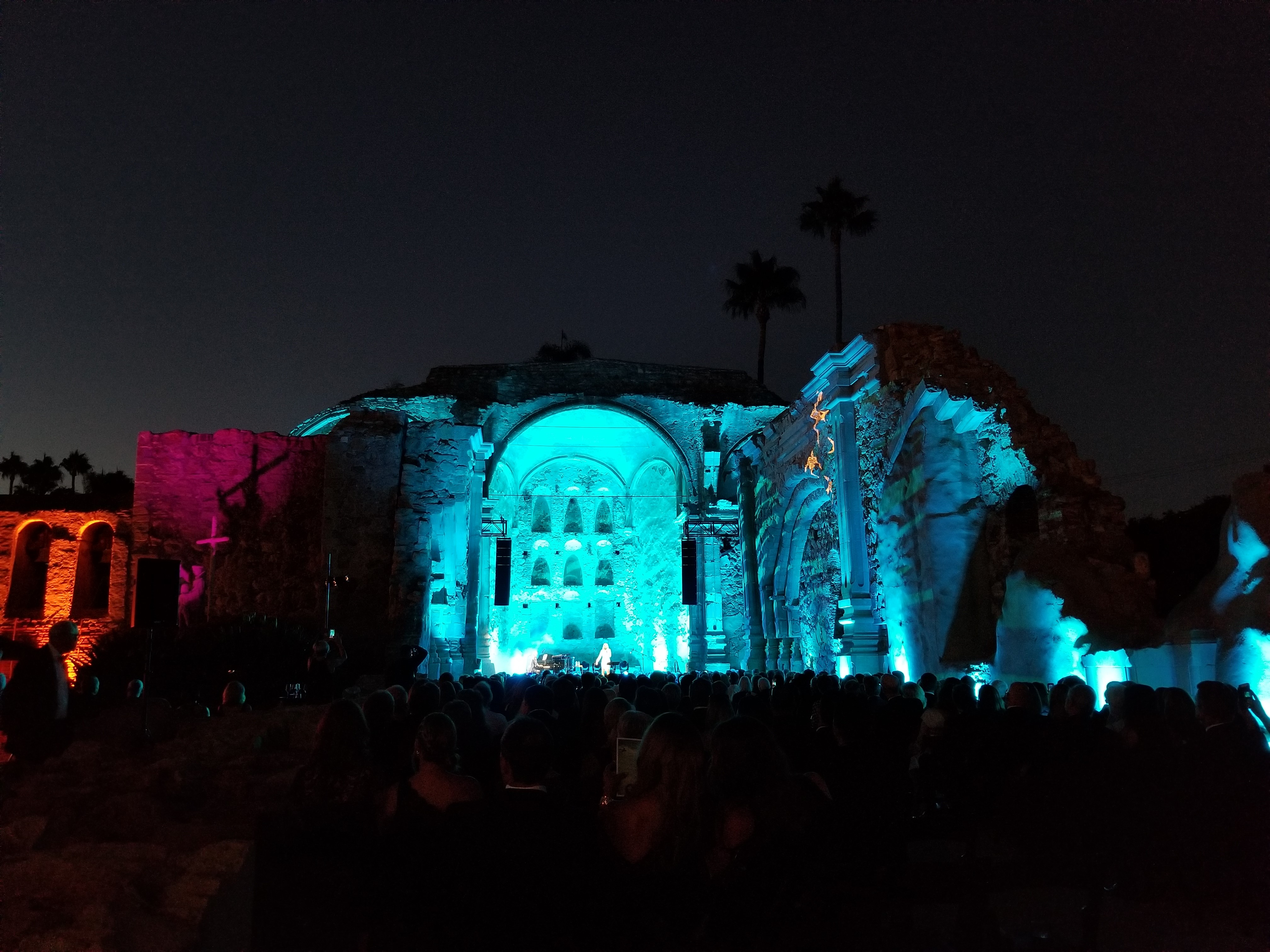 The ruins of the Great Stone Church are lit up in bright colors for the annual Romance of the Mission Gala on Friday, Sept. 14. Photo: Alex Groves.