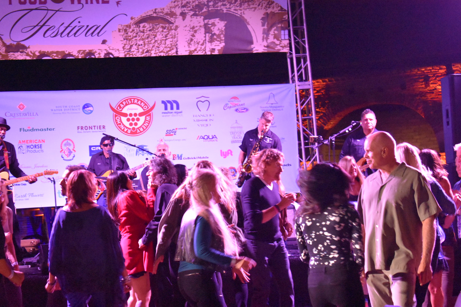 Visitors to The Vintage Food and Wine Festival dance to the music of Family style on Saturday, Oct. 6. Photo: Alex Groves