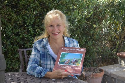 Donna Friess holds a copy of her new book Capistrano Trails at her home in San Juan Capistrano on Sept. 20. Photo: Alex Groves
