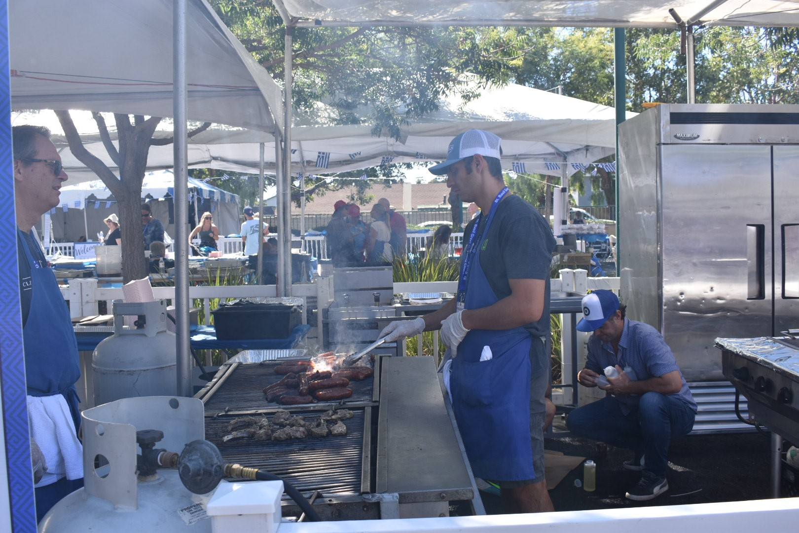 Sausage and lamb chops sizzle on the grill during the 2018 San Juan Capistrano Greek Festival on Saturday, Sept. 29. Photo: Alex Groves