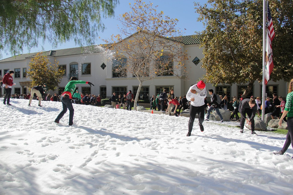 After breaking for lunch, students at JSerra Catholic High School waste no time launching snowballs at each other as part of the school's annual Snow Day on Thursday, Dec. 13. Photo: Shawn Raymundo