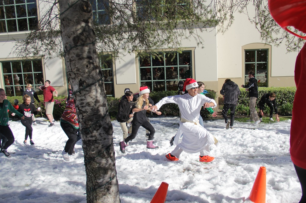Father Damien Giap leads pack of JSerra students during the school's annual Snow Day snowball fight. Photo: Shawn Raymundo