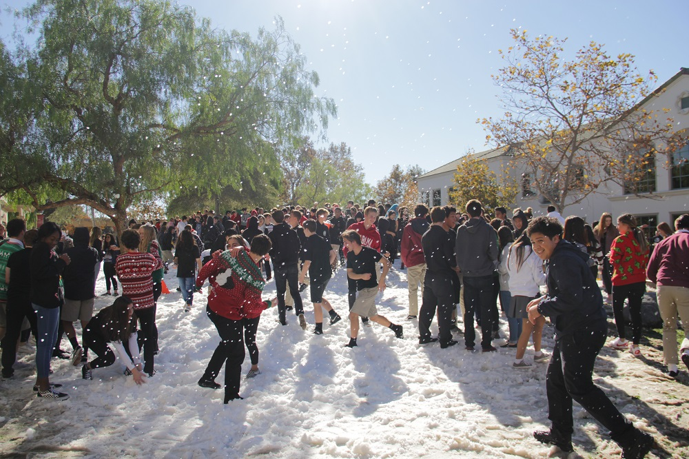 The JSerra annual Snow Day snowball fight is in full swing as students hurl and dodge snowballs. Photo: Shawn Raymundo