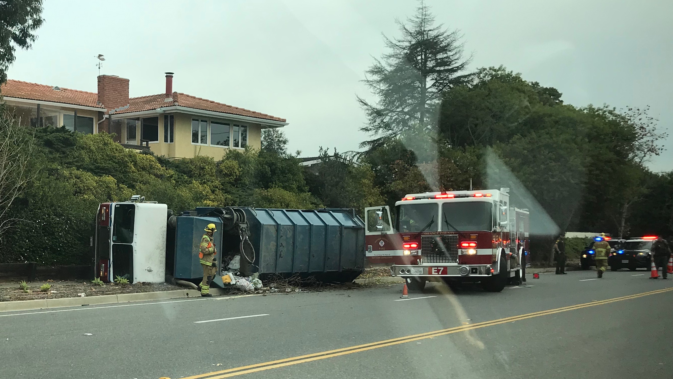 Orange County Fire Authority crews respond to a traffic collision involving a rolled over garbage truck at Del Obispo Street and Via Belardes in San Juan Capistrano the morning of Friday, Dec. 13. Photo Courtesy of Steve Behmerwohld