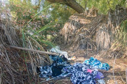 Homeless1: Various items such as blankets, shirts and a car battery were found at this location on Avenida Pico just west of Calle del Cerro on Tuesday, July 24. This location has had various evidence of human occupation for the last few years. Photo: Eric Heinz