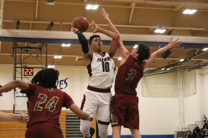 JSerra senior DJ Rodman has been a leading scorer for the Lions boys basketball team this season. He'll be relied on in a shortened Trinity League schedule. Photo: Zach Cavanagh
