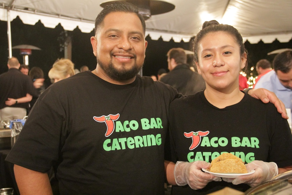 Representing Taqueros Mexican Restaurant at the Taste of San Juan on Thursday, Jan. 31, Cesar Lezama and Evelyn Cruz take a break from serving up crispy ground beef tacos to pose for a photo. Photo: Shawn Raymundo