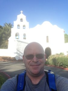 Christian Clifford, a high school teacher from San Mateo, takes a selfie outside of Mission San Diego during a recent stint of his ongoing pilgrimage to complete the California Missions Trail. Photo: Courtesy of Christian Clifford
