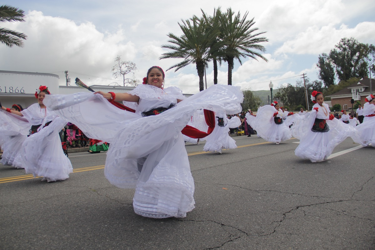 Members of the Ricardo's Place Restaurant entry perform a dance. Photo: Shawn Raymundo