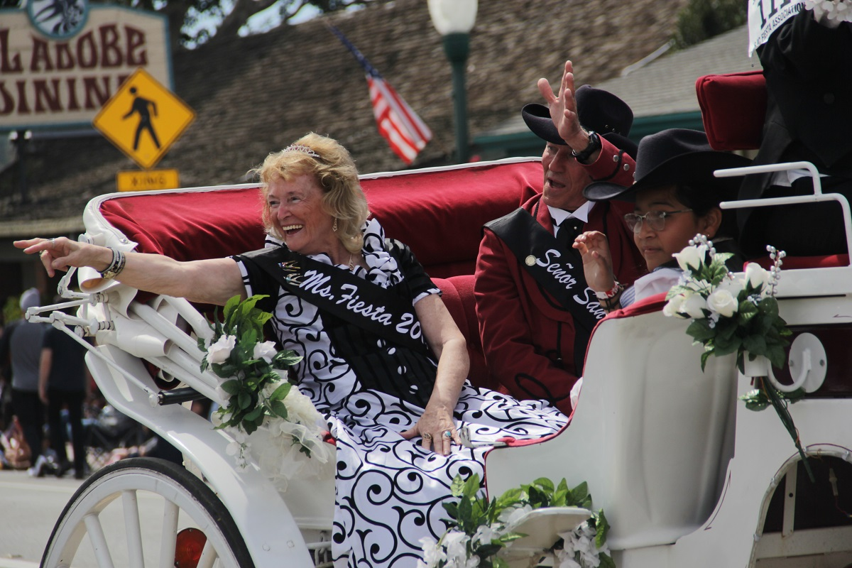 Swallows Day 2019 dignitaries Ms. Fiesta Annabelle Isky, Senor San Juan Tony Leone and Jr. Miss Fiesta Daniela Martinez wave to the crowd during the annual parade on March 23. Photo: Shawn Raymundo