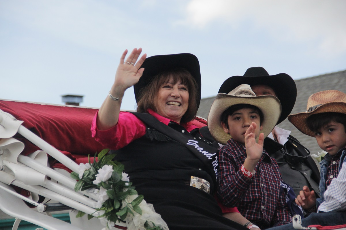 The Swallows Day Parade Grand Marshal Sylvia Mazzeo Pule gives the crowd a wave. Photo: Shawn Raymundo
