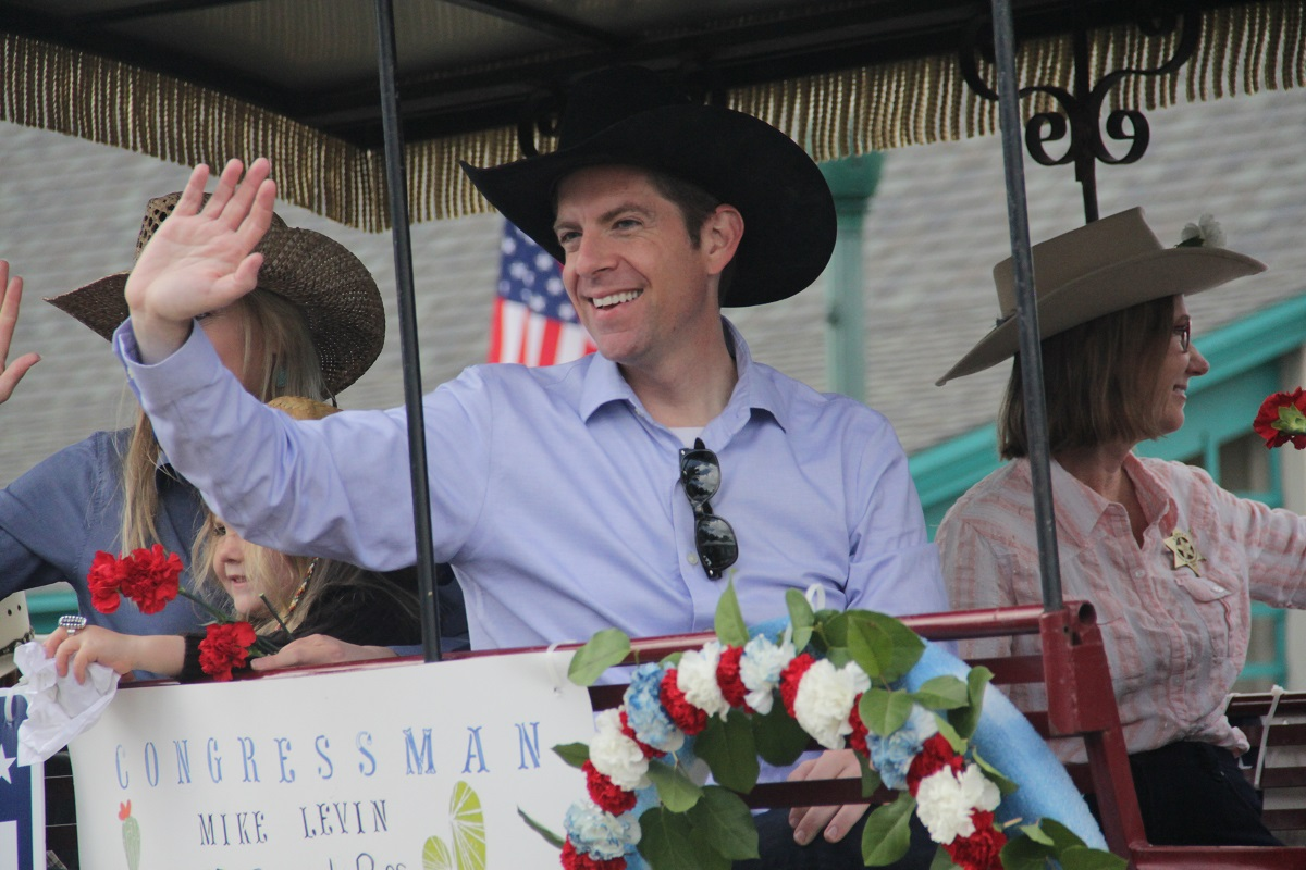 Rep. Mike Levin, D-CA, waves to the crowd at the Swallows Day Parade on March 23. Photo Shawn Raymundo