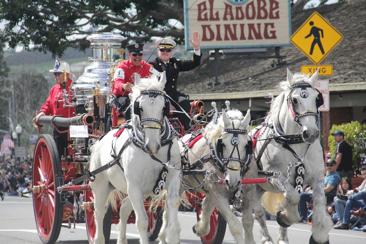 The California State Firefighters Association charge down Camino Capistrano during the parade. Photo Shawn Raymundo