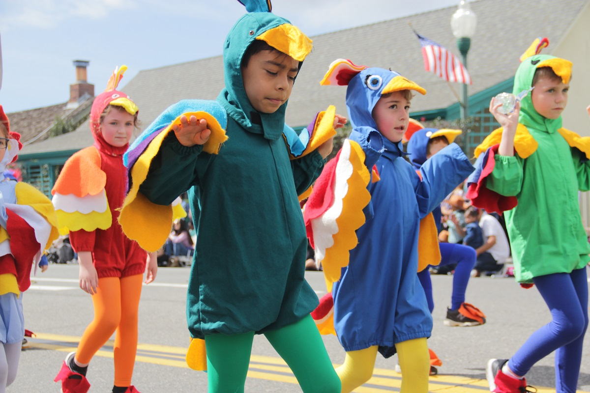 Kids from the Mission Basilica School trot through the parade dressed as swallows. Photo: Shawn Raymundo
