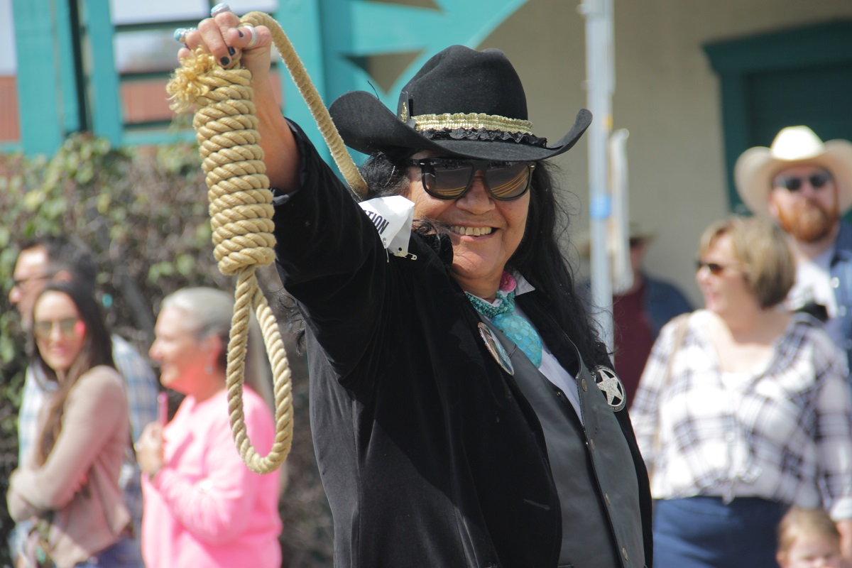 The Fiesta Association's 2019 Hanging Judge Carmen Phillips shows off her noose. Photo: Shawn Raymundo