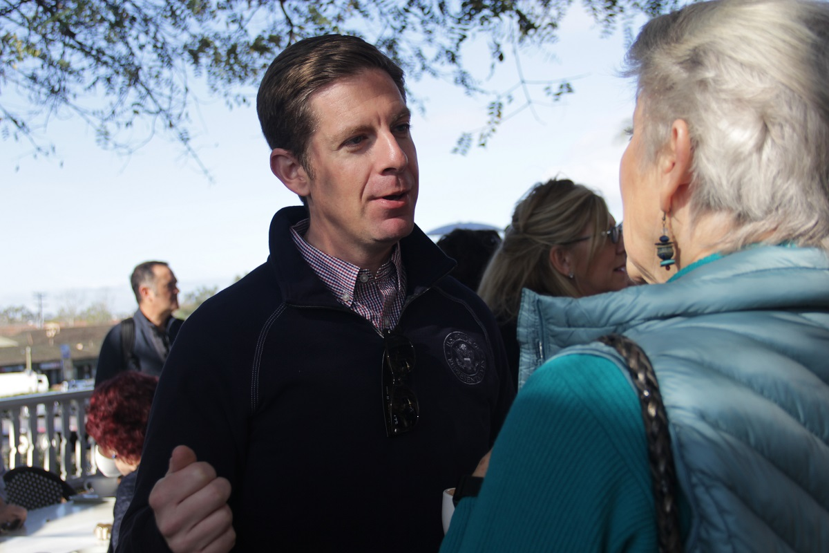 Rep. Mike Levin speaks with a local constituents for his inaugural Coffee with Your Congressman at Ellie's Table at Egan House on Friday, March 22. Photo: Shawn Raymundo