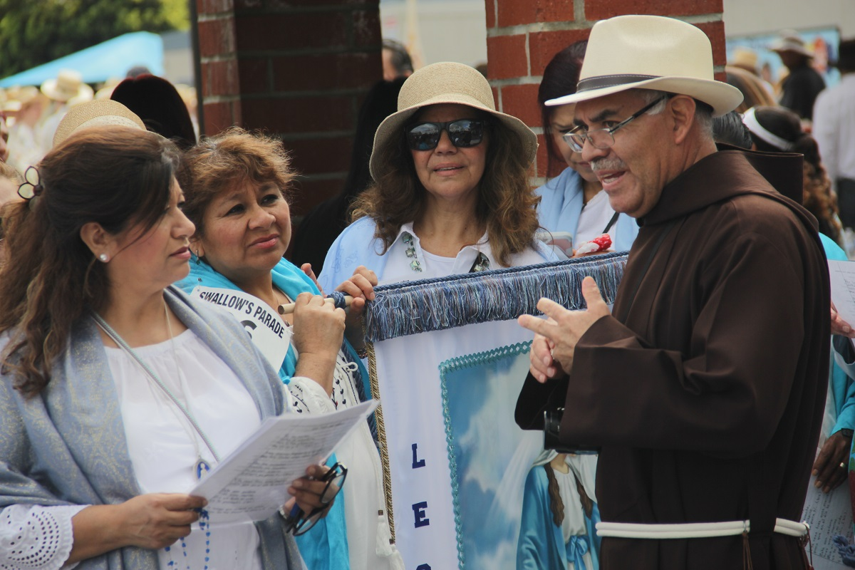 Father Domingo Romero of Legion of Mary coordinates with the rest of his group. Photo: Shawn Raymundo