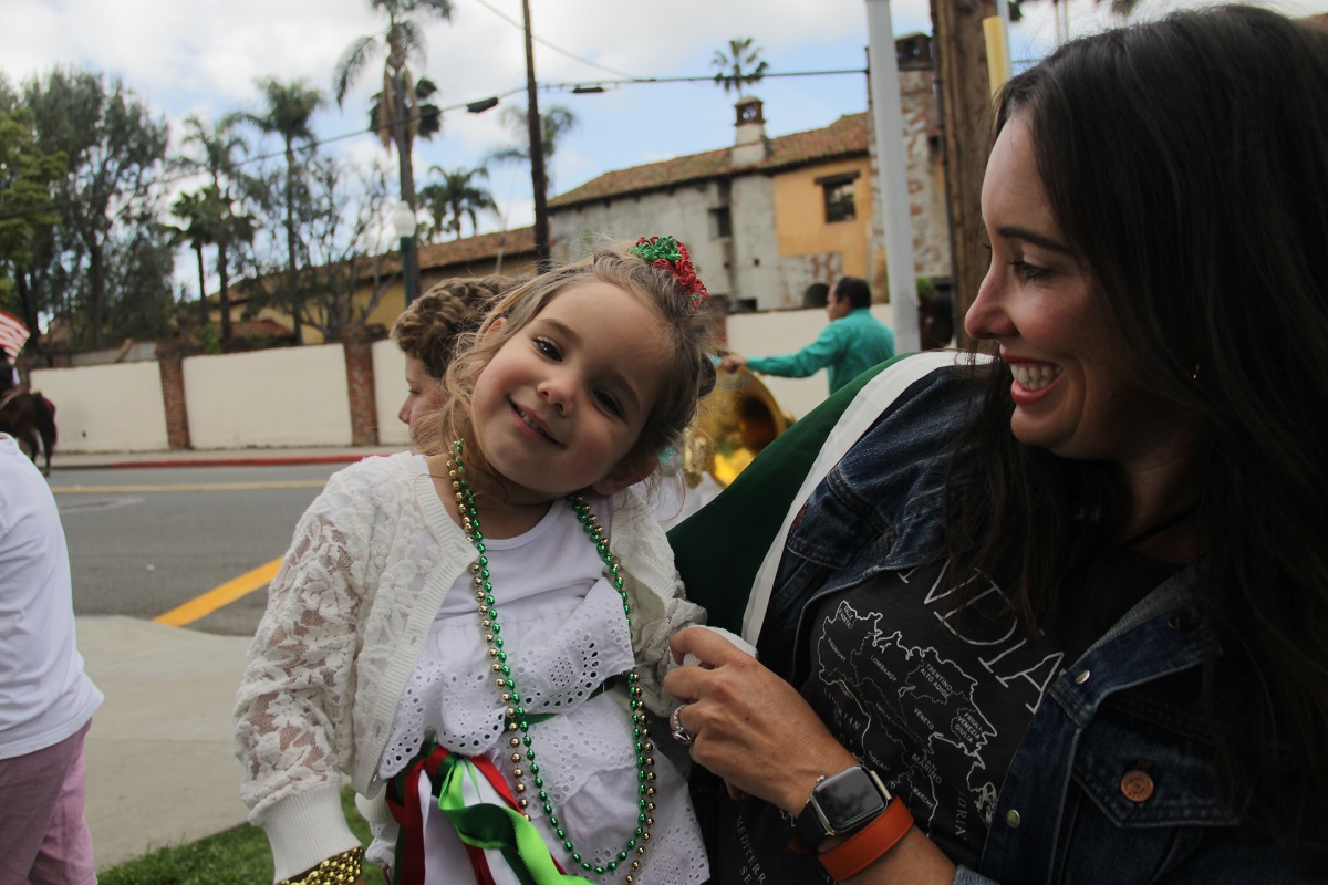 San Juan Capistrano resident Juliana Butoco Bianchi, 39, and her 3-year-old daughter, Jiada Antonia Brutoco Bianchi, pose for a photo before marching in the parade with the Italian Club. Photo: Shawn Raymundo