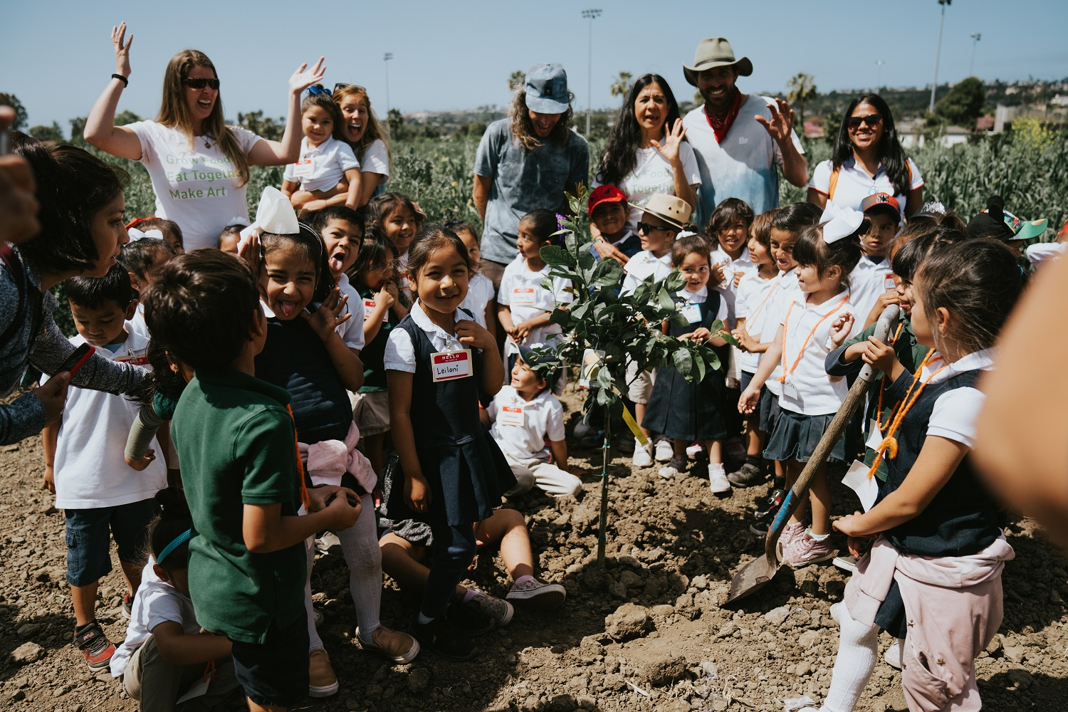 Kindergartners from Kinoshita Elementary School plant a citrus tree on Earth Day. Photo: Kat Reynolds of The Ecology Center