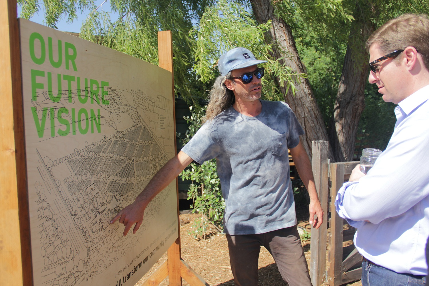 While giving Congressman Mike Levin a tour of The Ecology Center on Earth Day, Executive Director Evan Marks explains what the organization has planned for the farm's future. Photo: Shawn Raymundo