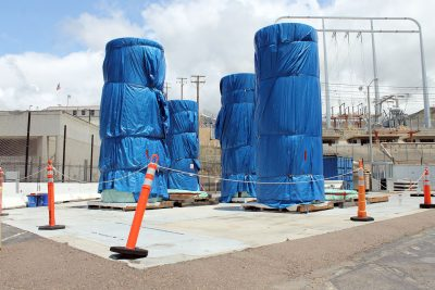 Canisters wrapped in plastic await to be filled with nuclear fuel rods containing spent nuclear fuel at a SONGS loading area. Photo: Cari Hachmann