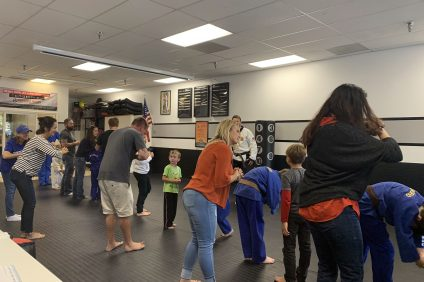 ZenDojoBullying: Parents accompany their children during a traditional bow of respect to each other and Zen Dojo Sensei Ian Miller on Thursday, May 23. Photo: Zara Flores