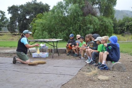 Kids listen intently to the instructions of their morning game exercises led by Leeta Lathan, the manager of Public Programs for The Reserve. Photo: Andrea Clemett