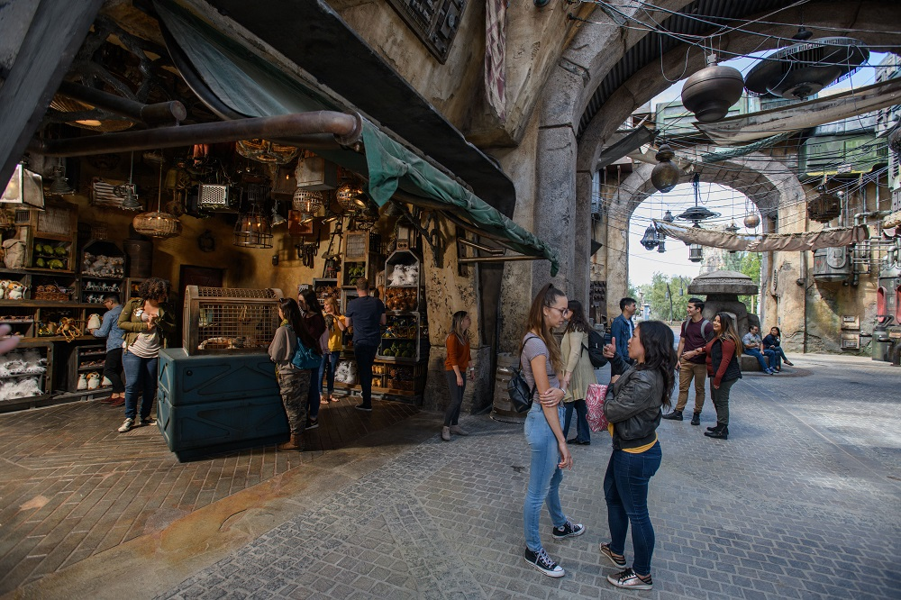 Guests visiting Star Wars: Galaxy's Edge at Disneyland Park in Anaheim, California, and at Disney's Hollywood Studios in Lake Buena Vista, Florida, will be able to wander the lively marketplace of Black Spire Outpost and encounter a robust collection of merchant shops and stalls filled with authentic Star Wars creations. (Richard Harbaugh/Disney Parks)