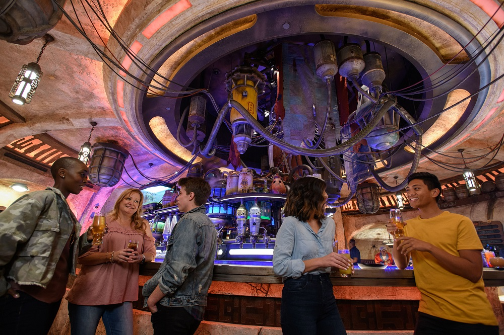 """When guests visit Star Wars: Galaxy's Edge at Disneyland Park in Anaheim, California, and at Disney's Hollywood Studios in Lake Buena Vista, Florida, they'll be able to enjoy Oga's Cantina - a local watering hole to unwind, conduct business and maybe even encounter a friend or a foe. Patrons of the cantina come from across the galaxy to sample the famous concoctions created with exotic ingredients using """"otherworldly"""" methods, served in unique vessels, with choices for guests of all ages. (Richard Harbaugh/Disney Parks)"""