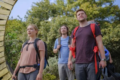 "This image released by A24 shows Jack Reynor, right, and Florence Pugh in a scene from the horror film ""Midsommar."" (Gabor Kotschy/A24 via AP)"