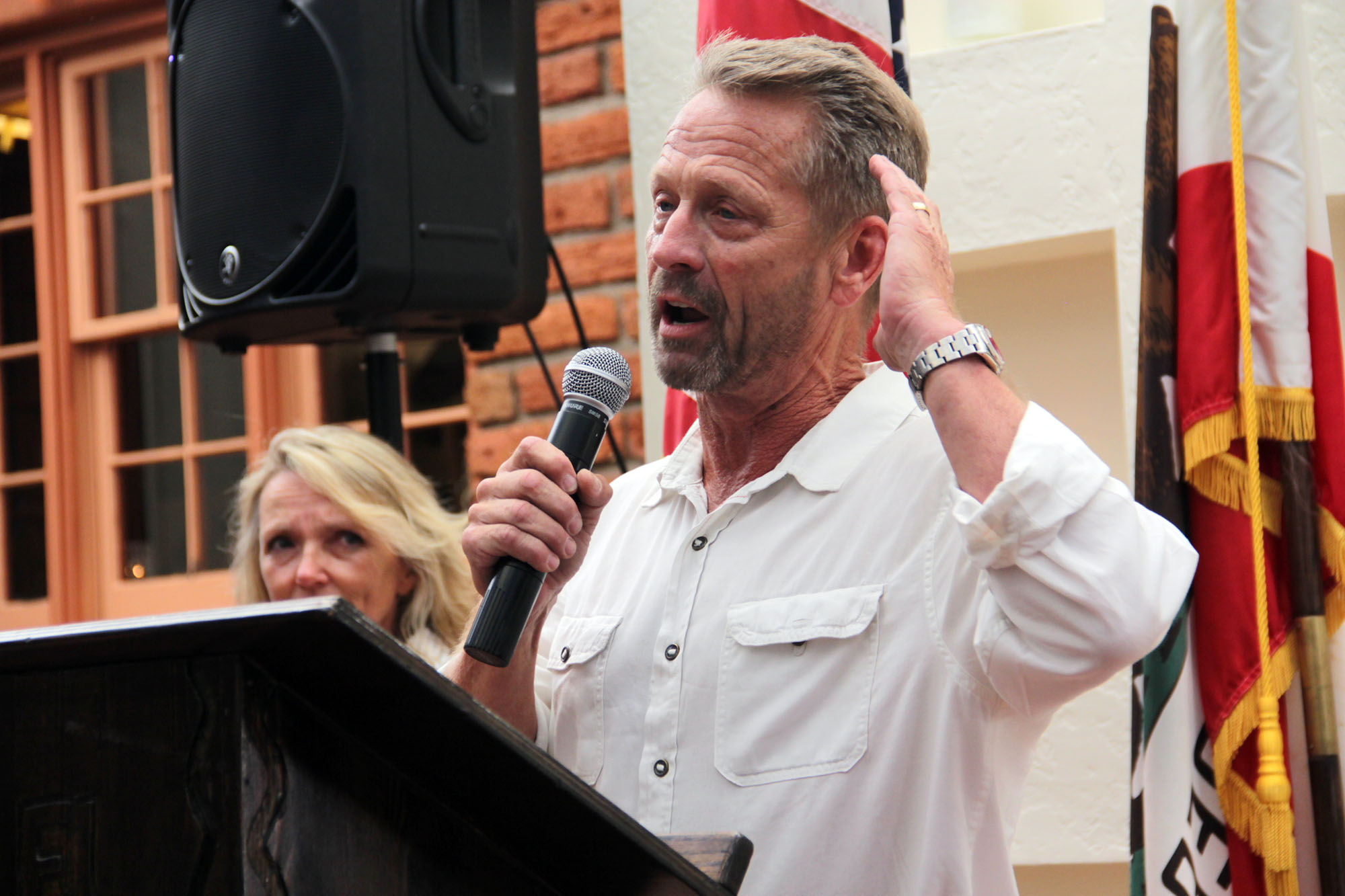 With his wife and business partner, Diana Schmitt, to his side, Scott Schmitt gives an emotional speech thanking the community after the couple received the San Juan Capistrano Chamber of Commerce's Man and Woman of the Year Award on Thursday, July 11. Photo Shawn Raymundo