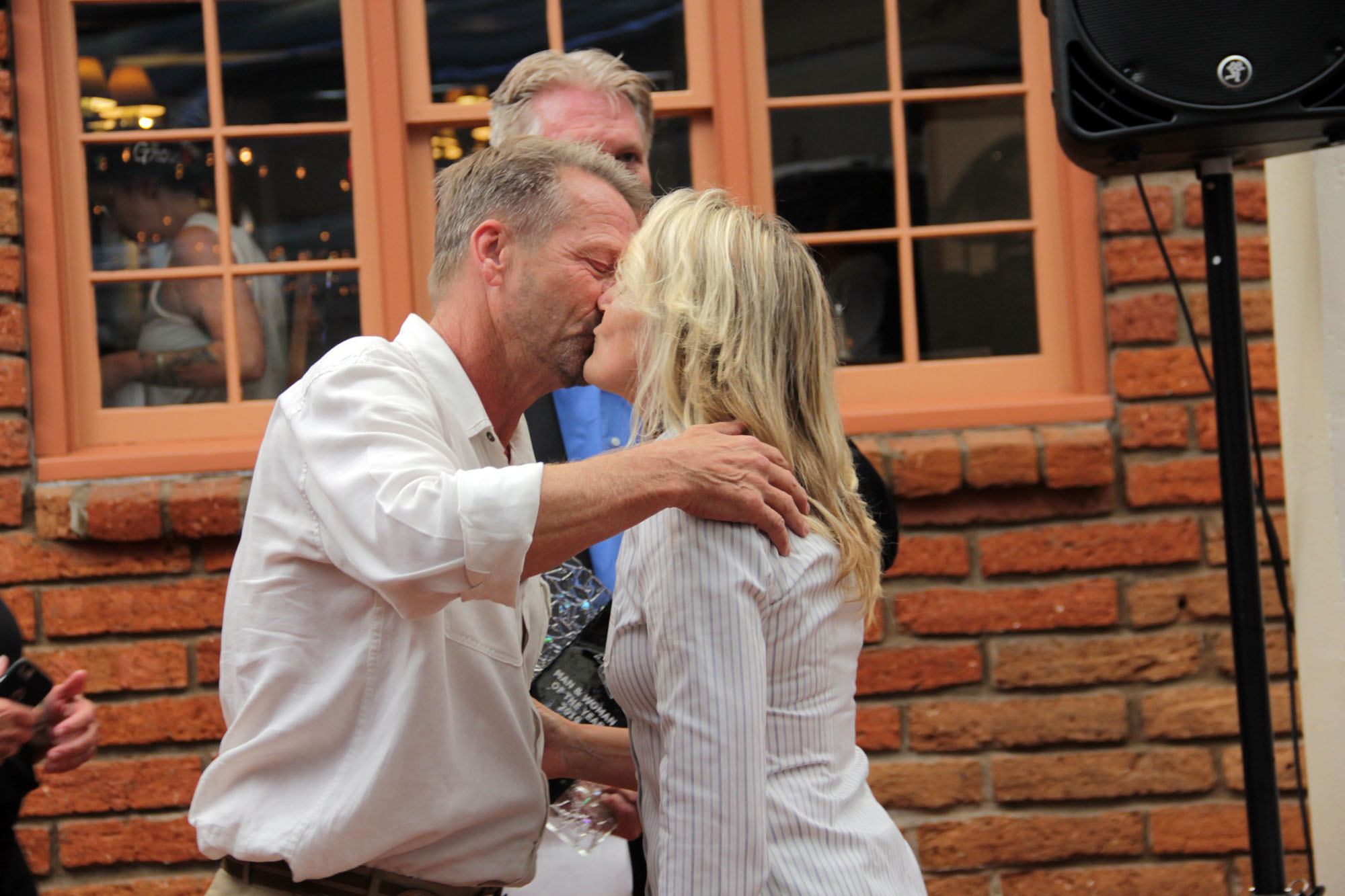 Scott and Diana Schmitt embrace for a kiss after being presented with the Man and Woman of the Year during the San Juan Capistrano Chamber of Commerce's Annual Installation and Awards Banquet on Thursday, July 11. Photo: Shawn Raymundo