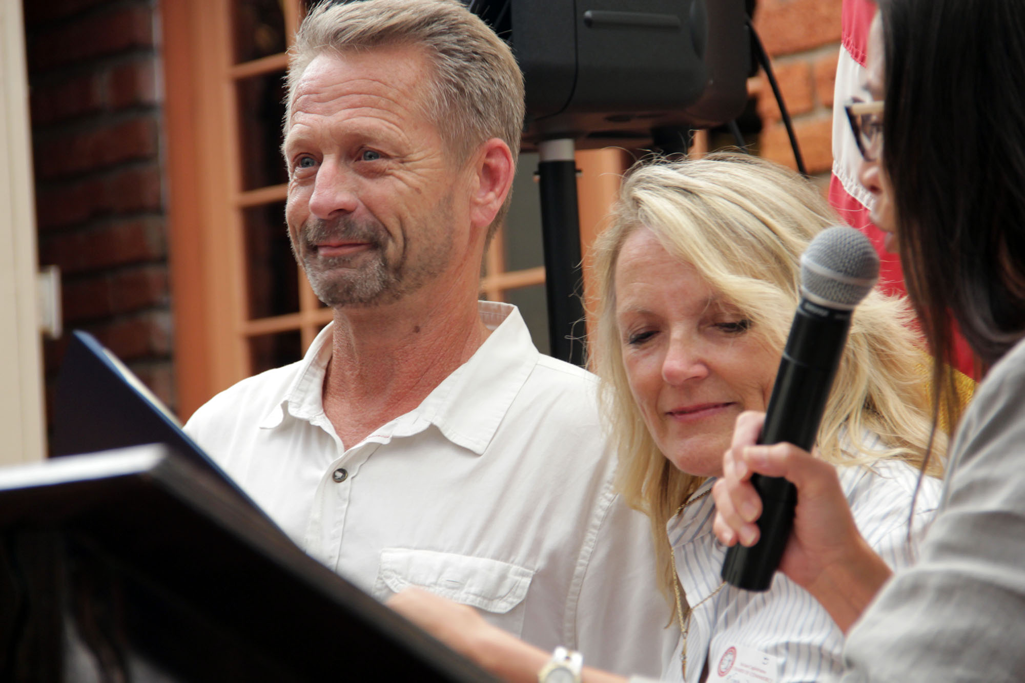 Scott Schmitt's eyes begin to water while he and his wife Dianna Schmitt receive the Man and Woman of the Year Award from the San Juan Capistrano Chamber of Commerce on Thursday, July 11. Photo: Shawn Raymundo