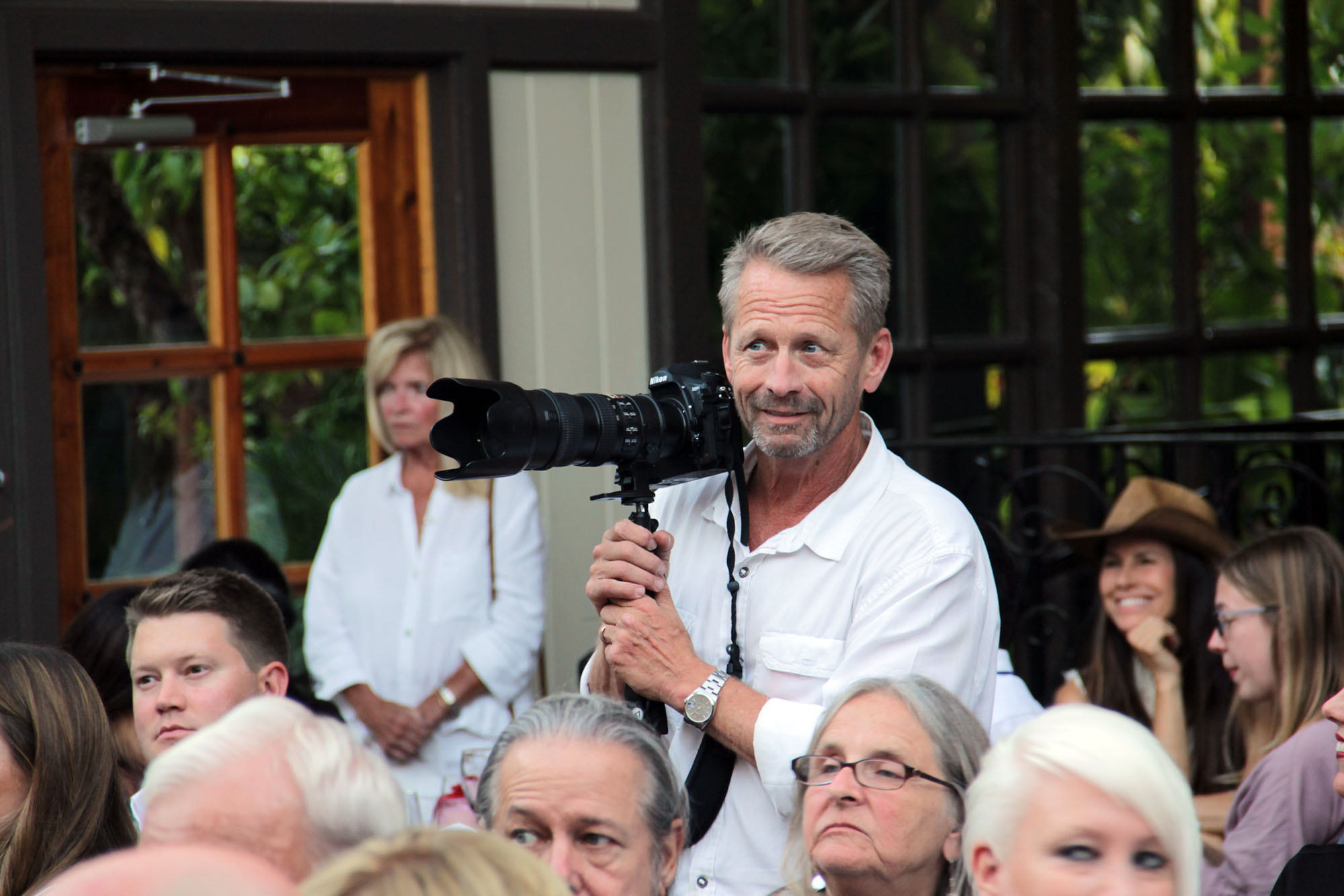 Scott Schmitt takes a quick break from photographing the San Juan Capistrano Chamber of Commerce's Annual Installation and Awards Banquet on Thursday, July 11, moments before he and his wife Diana Schmitt are recognized with the Lifetime Achievement Award. Photo: Shawn Raymundo